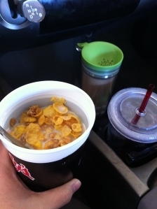 Honey Bunches of Oats cereal with 2% milk, coffee (green lid) and water (Starbucks water cup) - 303 calories