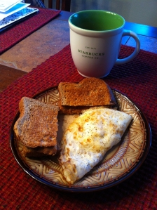 2 eggs, 2 pieces of whole wheat toast & coffee. 364 calories