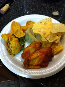 On my plate: chips & queso, potsticker, 2 chicken wings,