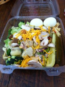 Lettuce, artichoke hearts, hard boiled eggs, mushrooms, pickles & croutons. 430 calories.