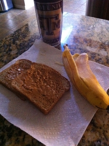 2 pieces of whole wheat toast & crunchy pb. Coffee with cream & sugar in the raw and a 1/4 banana. 324 calories.