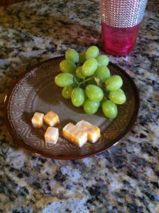 1 cup grapes & 1 serving cheese cubes.  182 calories.