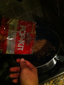The kit comes with the kernels and the oil to cook it in.  You just provide the pot!